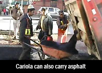 Image showing a Cariola carrying a full load of hot asphalt